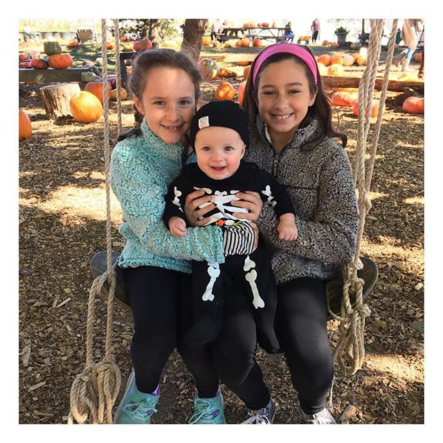 Sweetest family day with our little ladies + skeleton at the pumpkin patch! 🎃🧡🕸