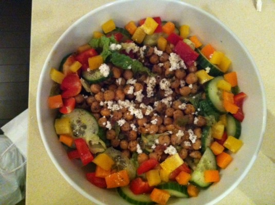 Chickpea salad, mixed with salad greens, peppers and some feta