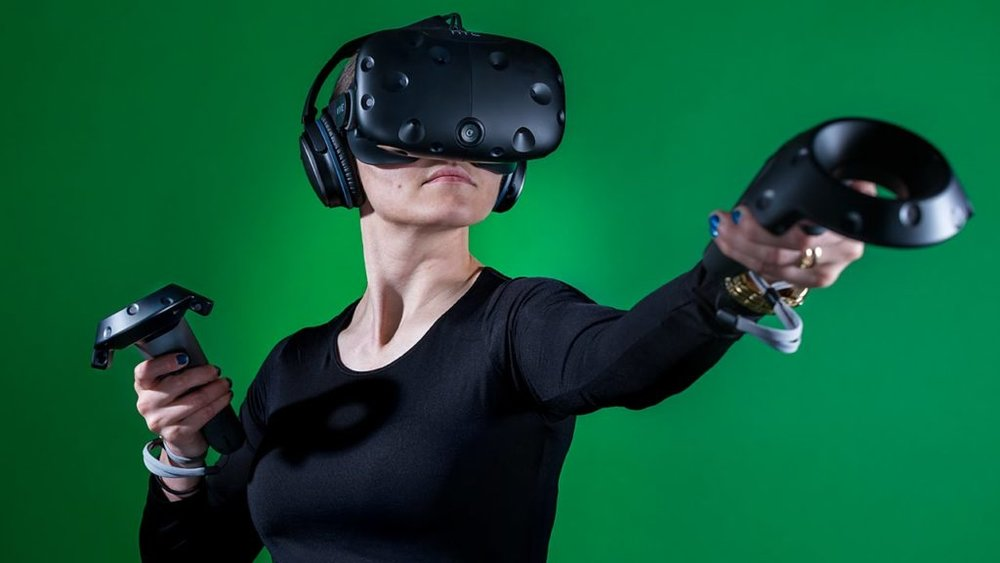 Virtual Reality - n.  the computer-generated simulation of a three-dimensional image or environment that can be interacted with in a seemingly real or physical way by a person using special electronic equipment, such as a helmet with a screen inside or gloves fitted with sensors.