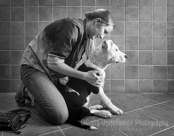 Craig Varjabedian's daughter works with a 4-month old Great Dane puppy at the Santa Fe Animal Shelter, 2013