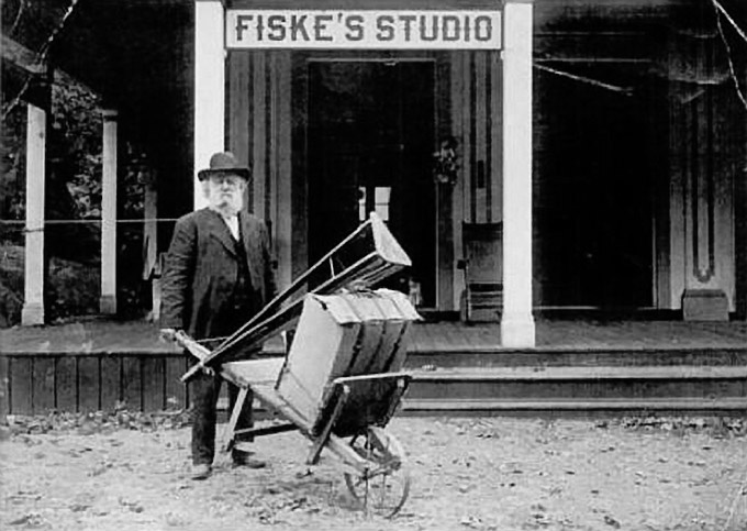 "Photographer George Fiske with his wheel barrow he christened ""Cloud Chasing Chariot"""
