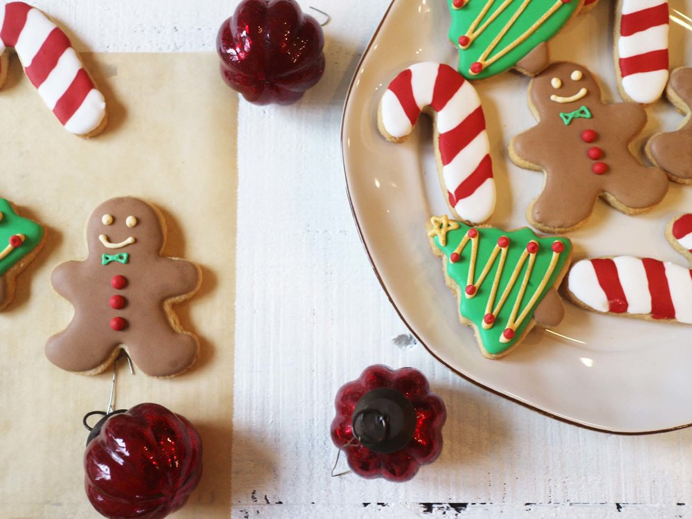 cookies on parchment and plate w ornaments.jpg
