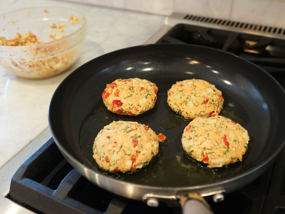 salmon cakes being cooked.jpg