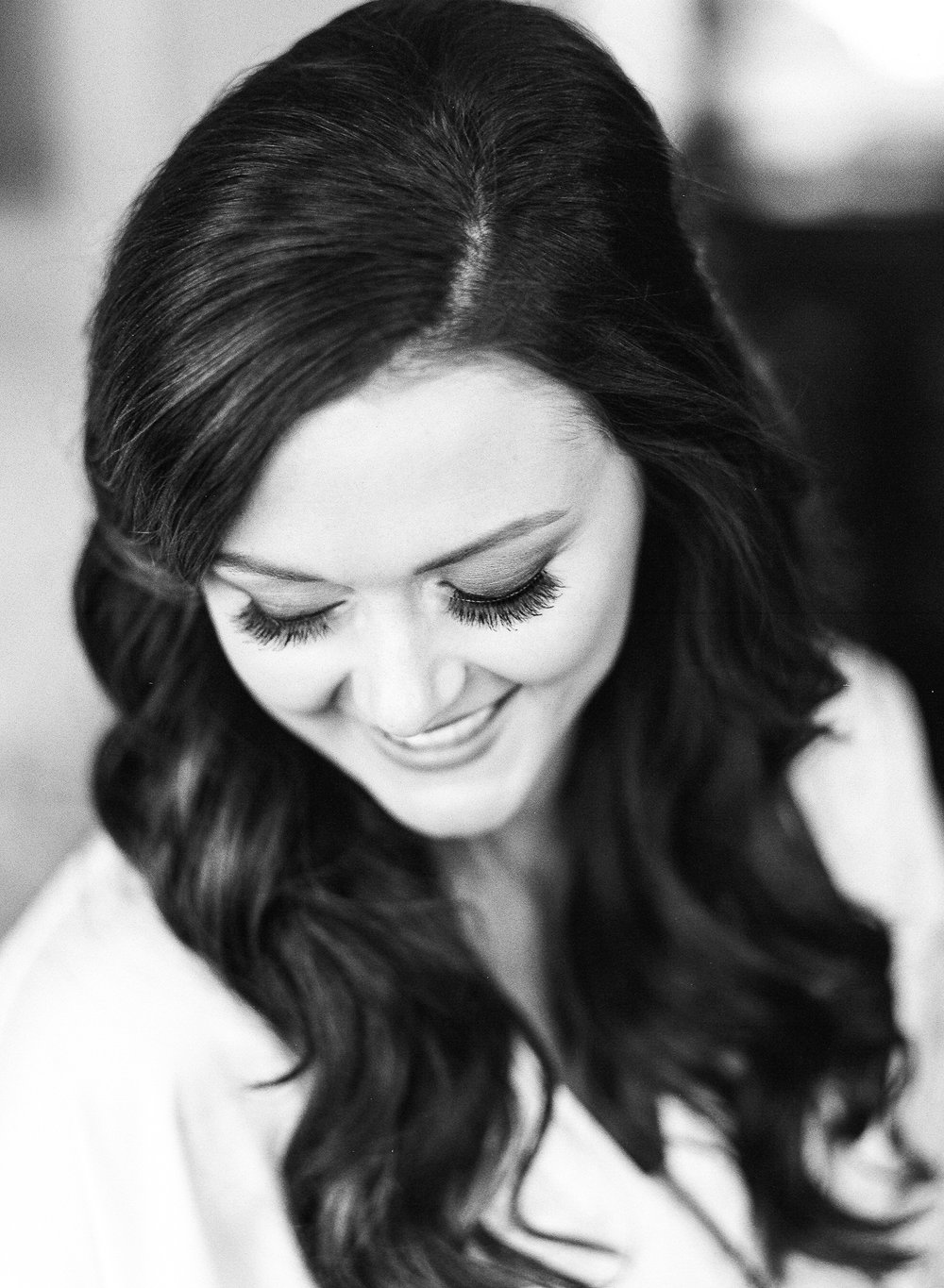 Black & white shot of bride looking down