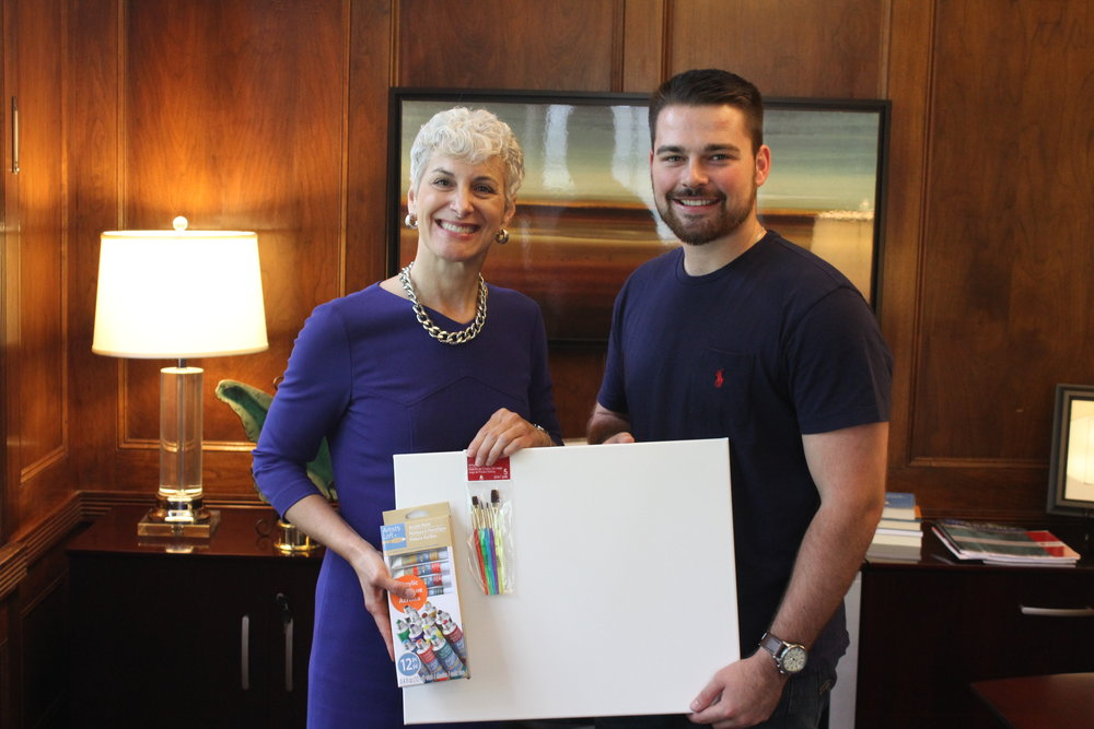 Illinois College President Barbara Farley stands with Illinois College student Lucas Marlow, who helped coordinate public relations efforts for the event as a requirement for one of his classes this semester.