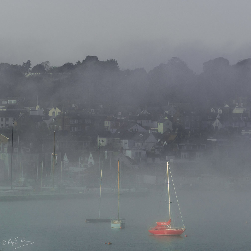 red boat in mist