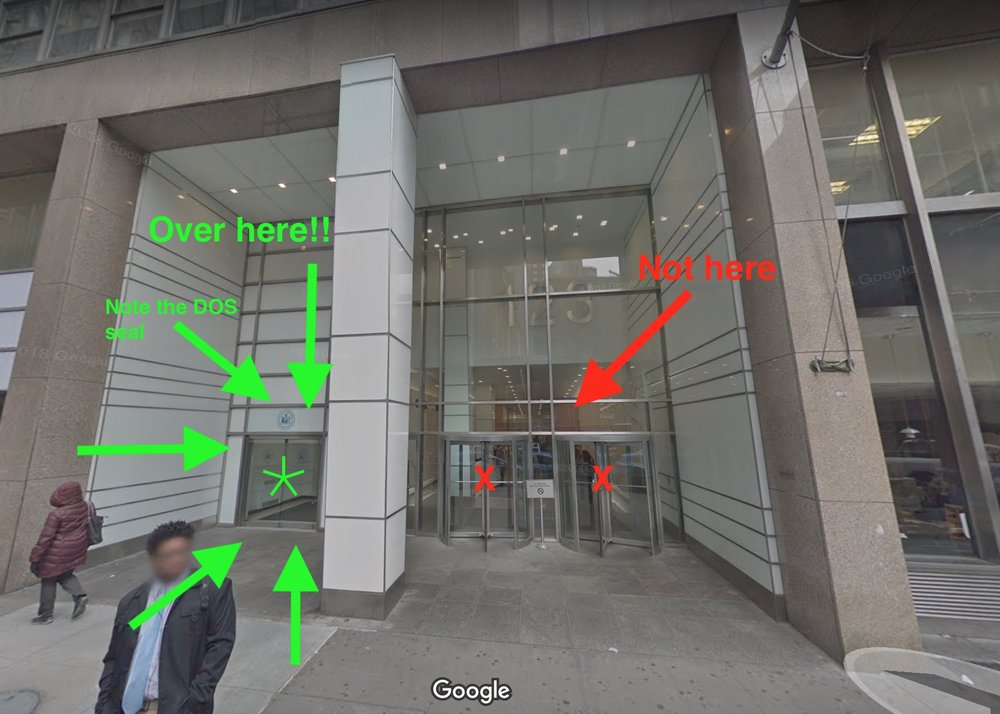 Google Street view image of the entrances to 123 William Street. Head to the entrance on the left with the tiny blue Department of State seal over the entrance.
