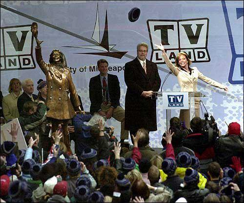 Mary Tyler Moore tosses her hat into the air at the unveiling ceremony for her statue in Minneapolis