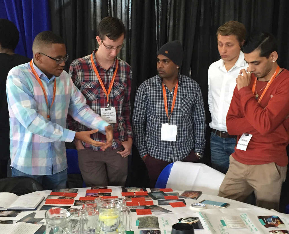 HackJozi 2016 teams discuss the results of their ethnographic research.