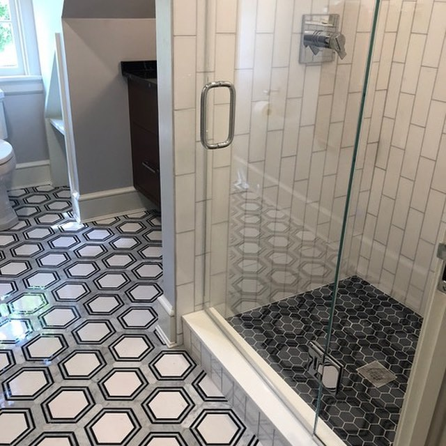 This guest bath is finally complete! We carved it out of an odd room of dormers and multiple doors. The old room to a room now houses this black, white and gray full bath and a dressing room on the other side. ⠀ ---⠀ .⠀ .⠀ .⠀ #masterbath #bathroominspo #bathroomrenovation #bathroomremodel #bathroomdesign #tiledesign #geotile #geometricdesign #hextile #interiordesign #designer #interiors #home #homedesign #interiordesigner #designlife #belladesign #richmond #RVA #804 #renovation #redesign #remodel #homerenovation