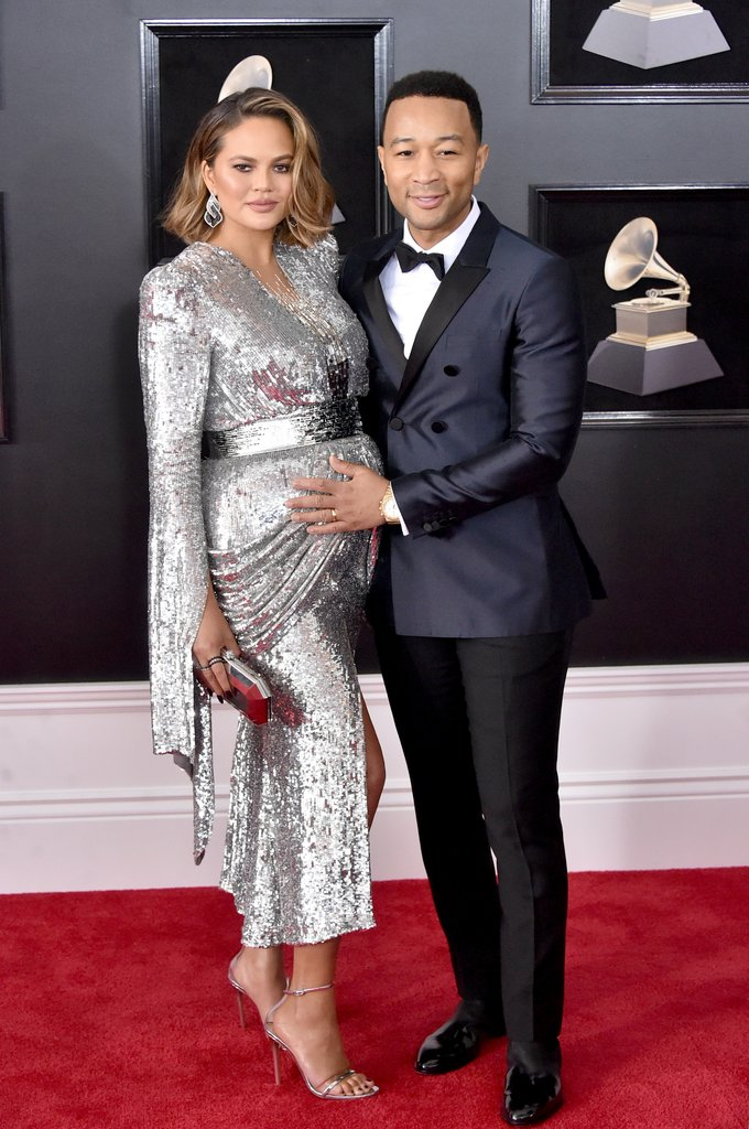 CHRISSY & JOHN - Whenever this power couple hits the red carpet I'm always a fan of what they are wearing. John showed up in a classic navy suit while preggo Chrissy stole the show shinning bright like a diamond. I love the sleeve detail this dress had! Props to Monica Rose for styling her and making her look amazing