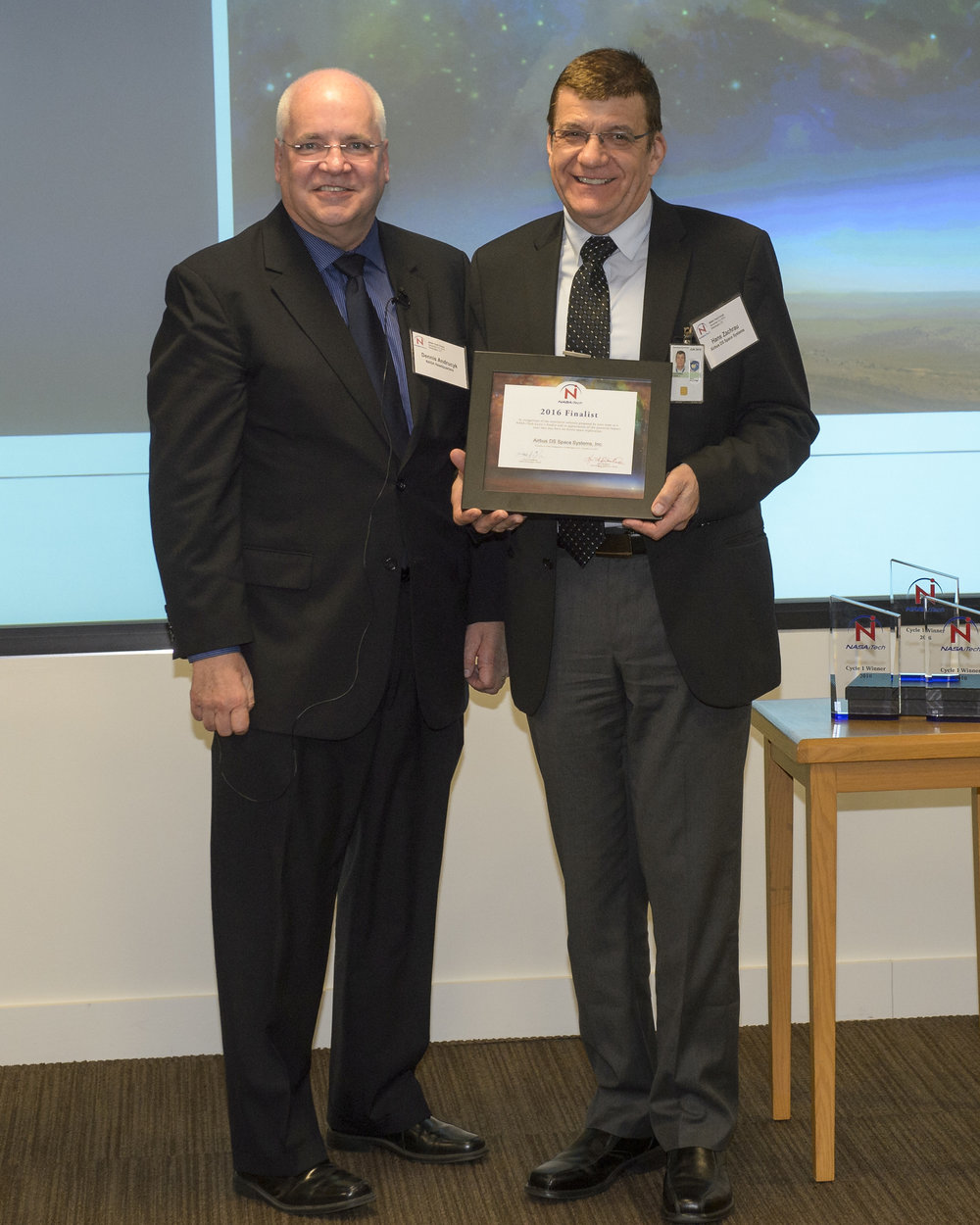 Hans Zachrau, from Airbus DS Space Systems, MAPT Team, accepts a certificate from Acting Chief Technologist Dennis Andrucyk recognizing the organization as a 2016 NASA iTech finalist.