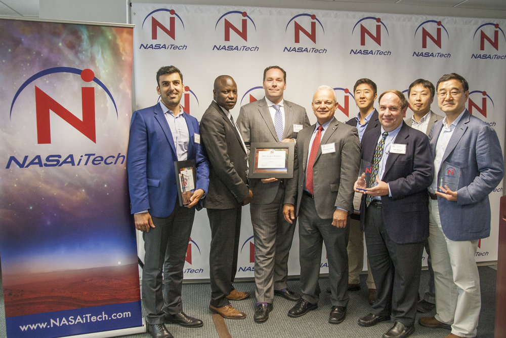 NASA Chief Technologist, Douglas Terrier recognizes the winning teams at the NASA iTech Cycle 2 Forum on July 13, 2017.