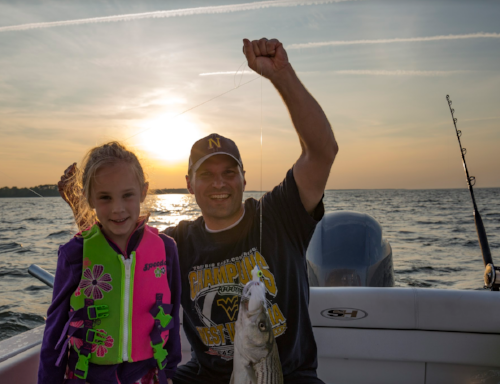 "Co-Owner Marcus Sheridan and his daughter ""Pink"" after a Rockfish catch"