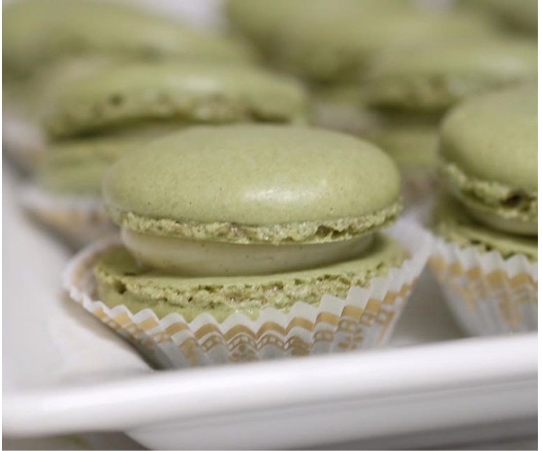 Macarons in Good Skin Day green made by Elle's Patisserie for Courtney's launch party
