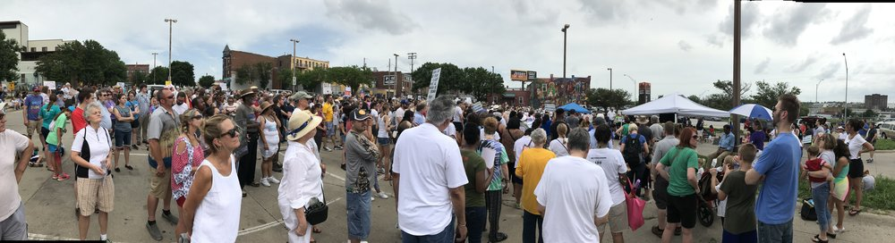 People gathering for Omaha's Families Belong Together rally.