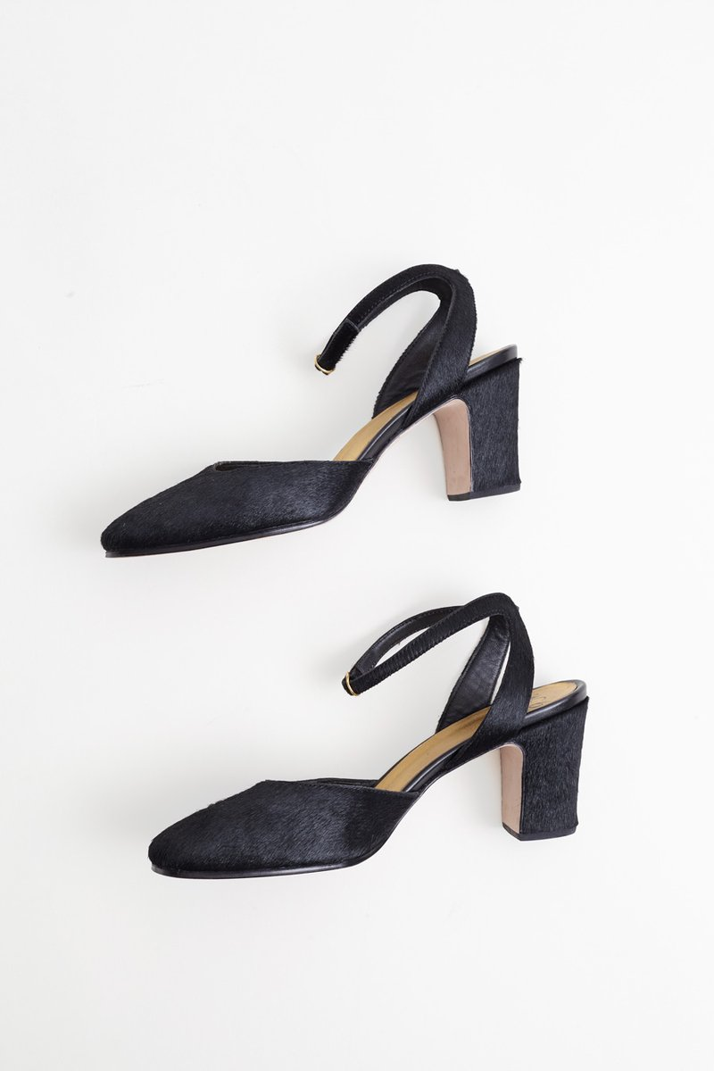 No one ever conquered the world in bad shoes, and these are the ultimate step up pair — whether you're taking on a NYC Comedy Club, crashing a Paris drag show, or navigating a 21st-century office holiday party. Paloma High Heel by No. 6 in Black Pony, sold out online but available at  The Mix Shoes and Accessories  in Omaha.