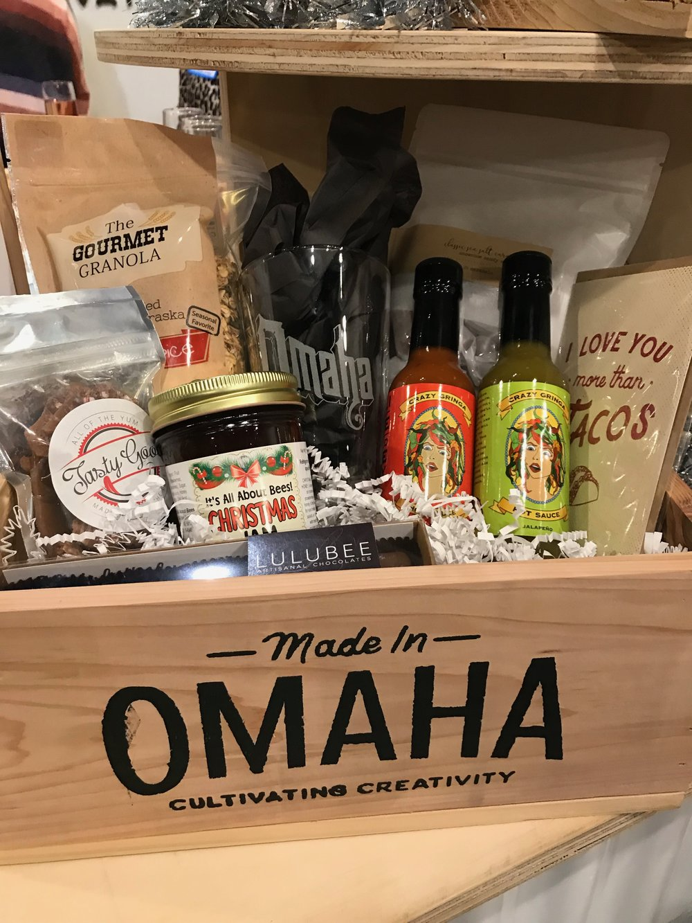 A Made in Omaha custom gift box for the gourmand includes locally made jam, granola, hot sauce, toffee, chocolates and other treats.