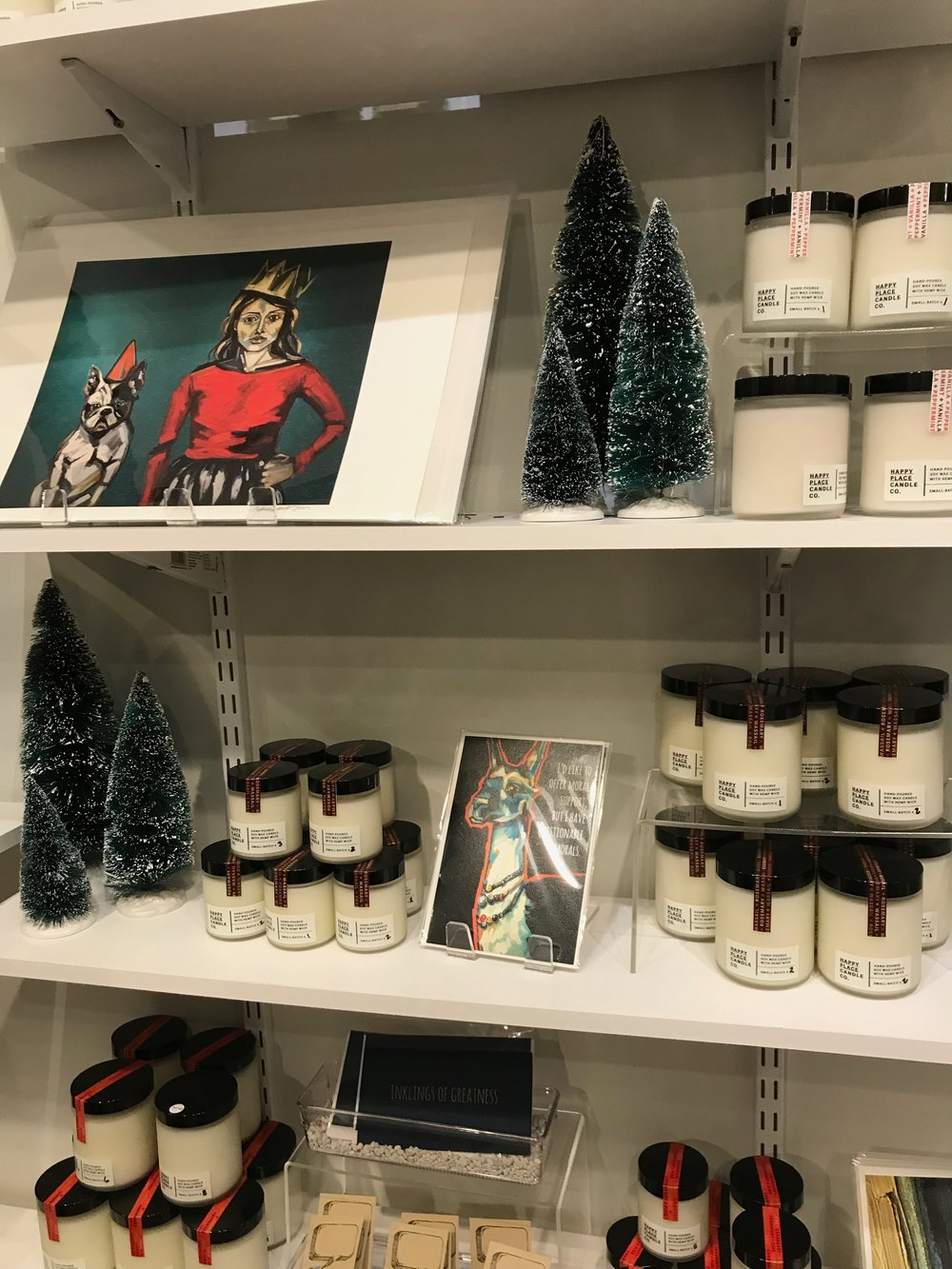 A holiday-themed print by local artist Andrea Stein and candles by Happy Place Candle Company.