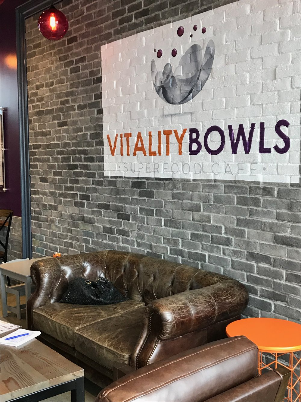 The Omaha location of Vitality Bowls has a homegrown vibe, with a logo designed by Omaha artist Maggie Weber and locally sourced Nebraska barn wood furniture and fixtures. The store also features locally produced beverages including Artemis Tea, Hill of Beans coffee and on-tap Kombucha from FishEye Kombucha.