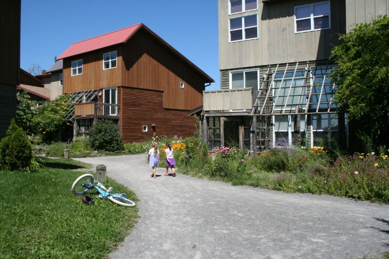 Eco-Village-Children-plus-bike-800x533.jpg