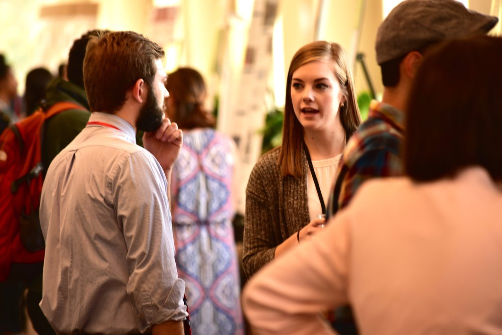 Students engage in lively conversation on many topics, all unique but connected, at an IRIS 2017 poster session.