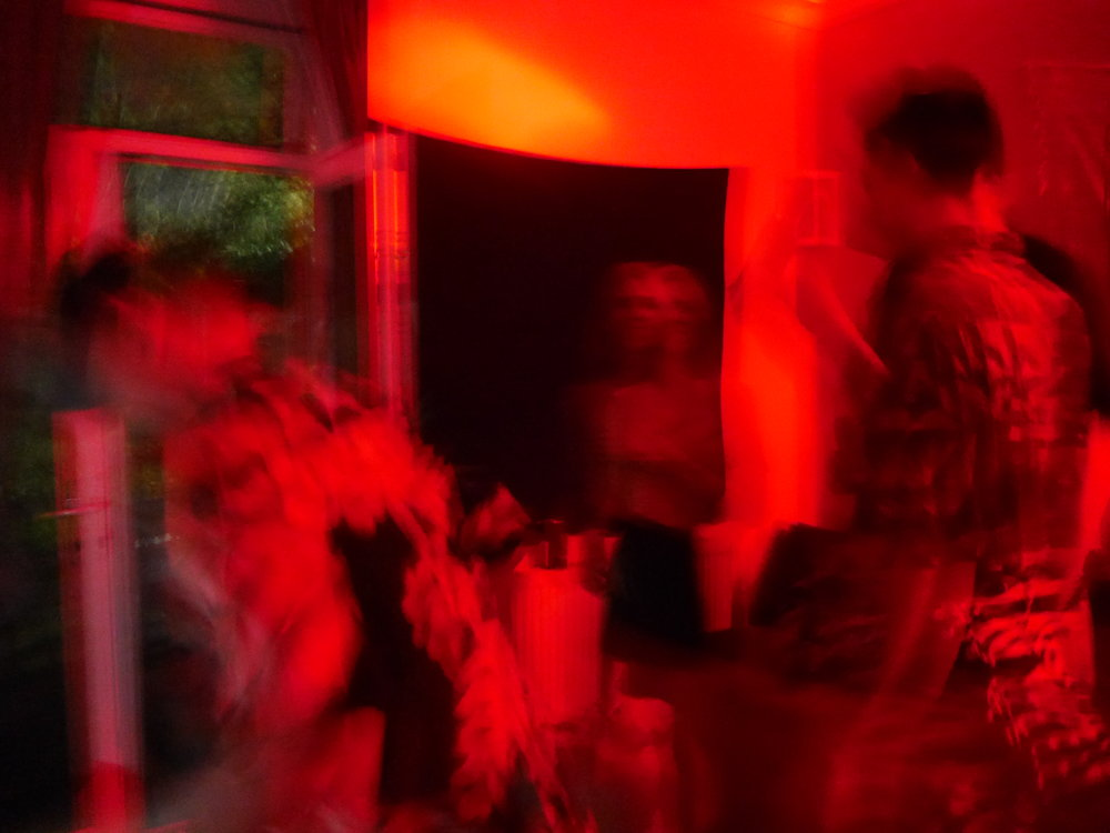 Strangers mostly at a party, March 2018.
