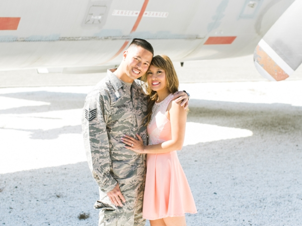 Couple embracing at Moffett Field in Mountain View, CA.