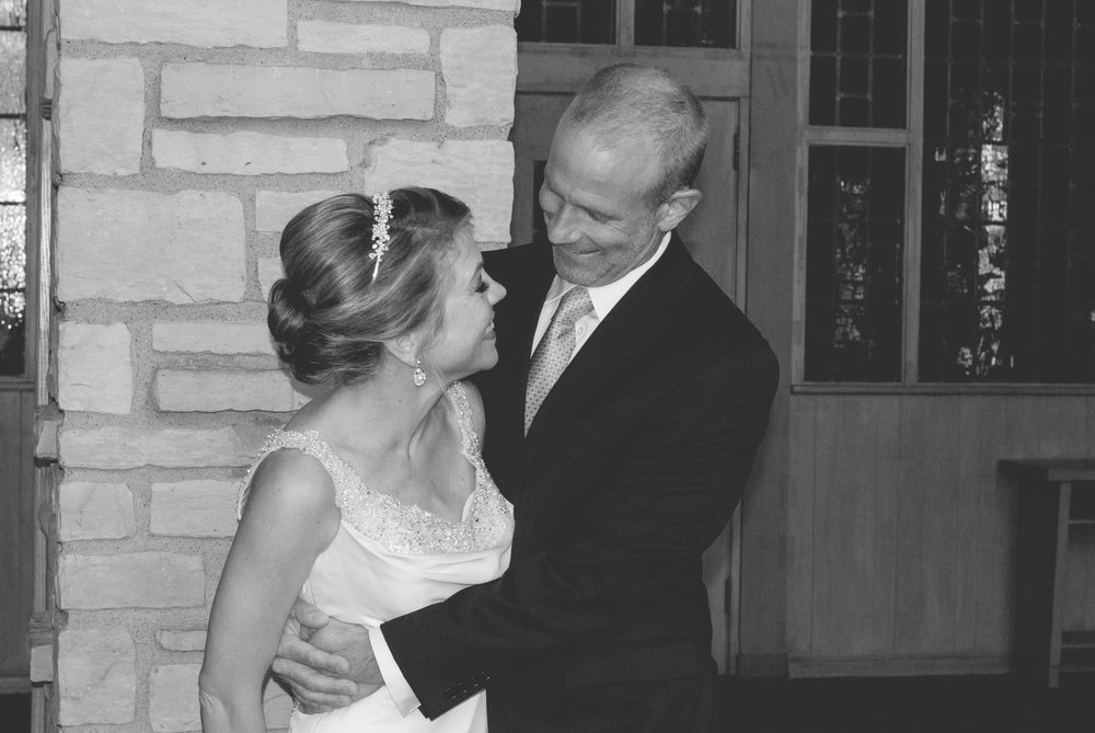 """- """"Alex provided beautiful memories from our wedding. She captured our joy as well as our personalities in her photographs. She is flexible, friendly, and easy to work with. She was even able to help my husband create a very unique and special picture as a wedding gift to me!""""                  - Lara & Doug"""
