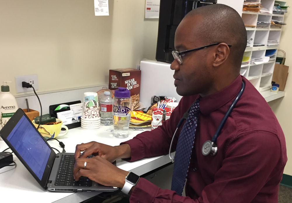 med student David Asuzu  documents a patient visit