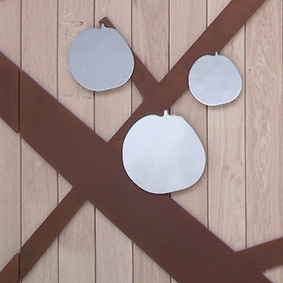 Corten, stainless steel and oak