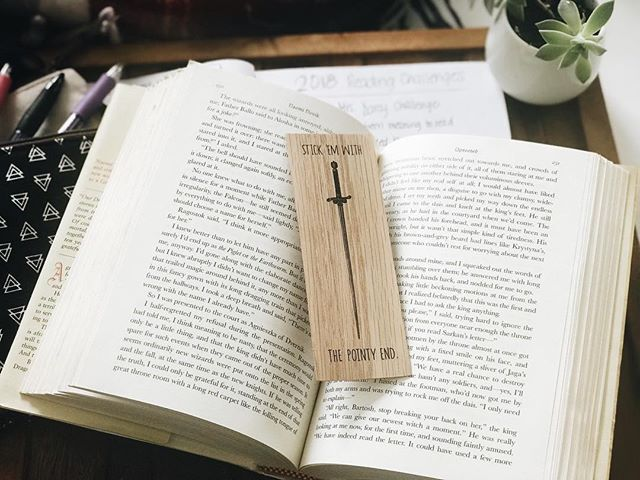 My favorite book mark to date: Arya quote FTW! I'm starting to miss Game of Thrones so much that I'm considering rewatching all seasons 🤣 who's with me?! Haha . . I haven't finished a book yet in 2018 and I feel kind of bummed! But, I'm reading 4 books and I'm halfway through all of them, so I guess I would have finished one had I been decisive about what to read next. I'm actually more than halfway through The Chalk Man and can't wait to talk about it! I'm loving it. . . What are your reading plans this week? . Also no, I'm not a rep, but @in.the.reads is the bomb.com and she made this bookmark so go check her out for more rad merch 🖤