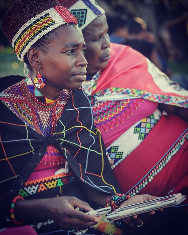 Zulu Princess keeping up with the times on her tablet and smartphone. Building bridges between the modern world and ancient traditions.