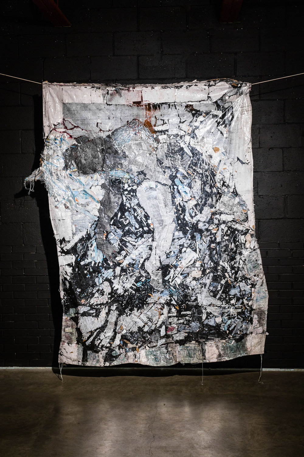Kyle B. Co. / Dying of Thirst in The River / white male marks, graphite, mixed media and collage - on clothesline / ~72 in x 89 in / 2017