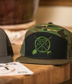6b7cb5870fd1a McGill Black camper hat with Olive logo. 30.00. 012.jpg. Richardson 7panel  snap back Camo with Green logo