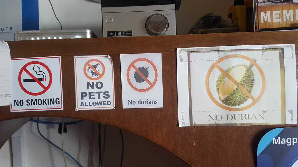 Extra double sign emphasis for No Durian. Posted behind the check-in counter at a hostel in Penang, Malaysia.  Photo taken:March 21, 2017