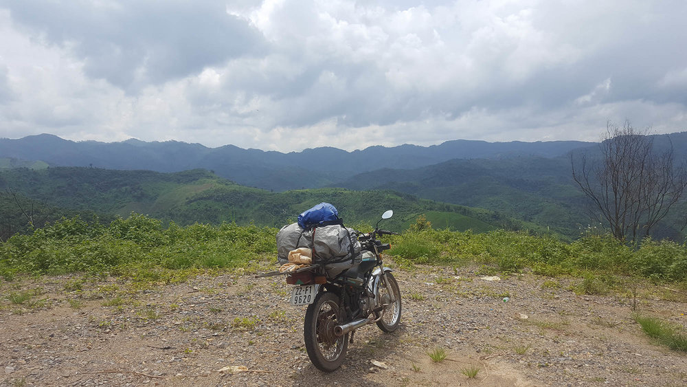 laos-mountains-motorcycle.png