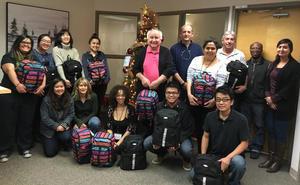 Some of the viiz Calgary team members who participated in the Stephen's Backpacks project.