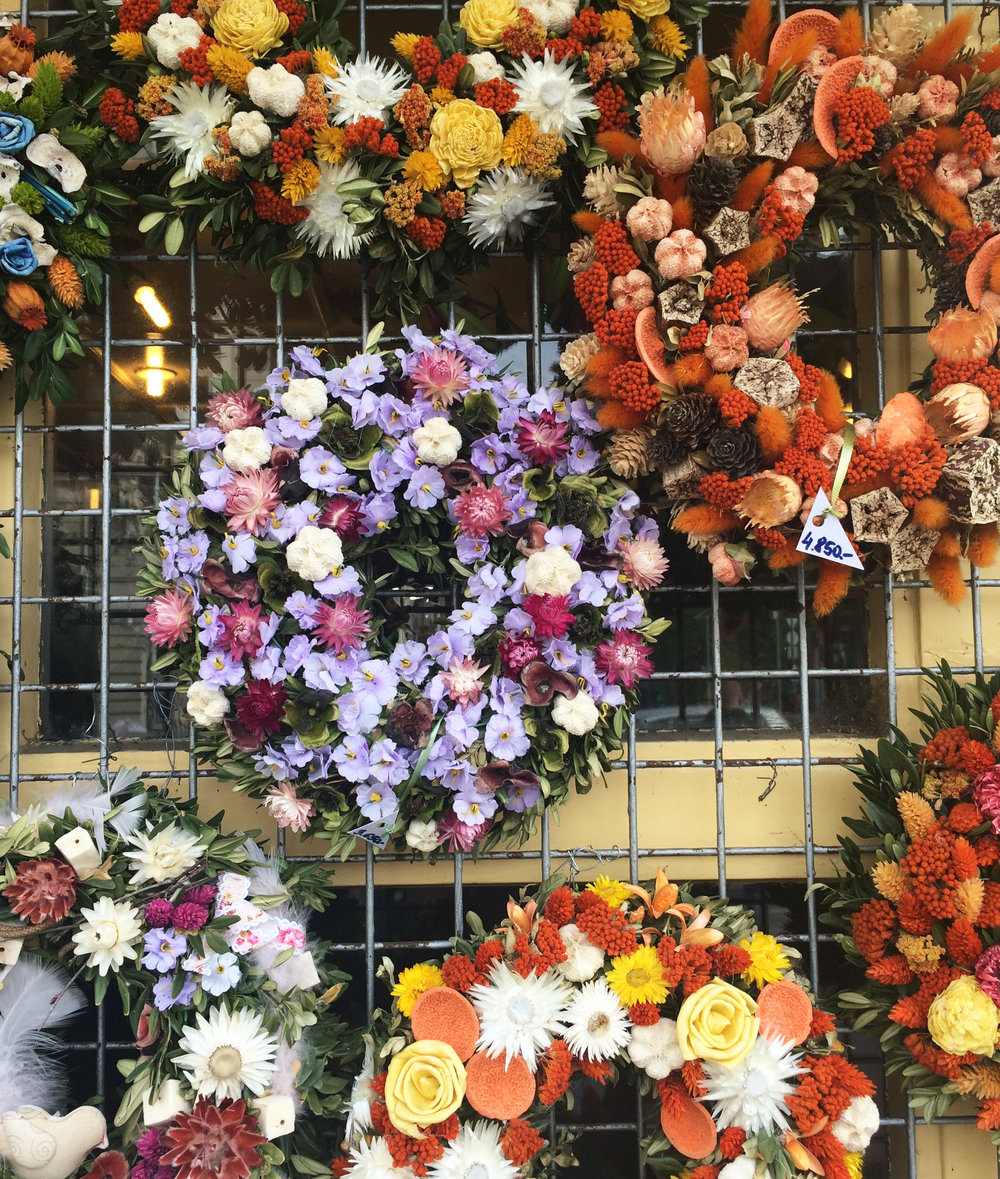 Flower wreaths at a stall on our way home