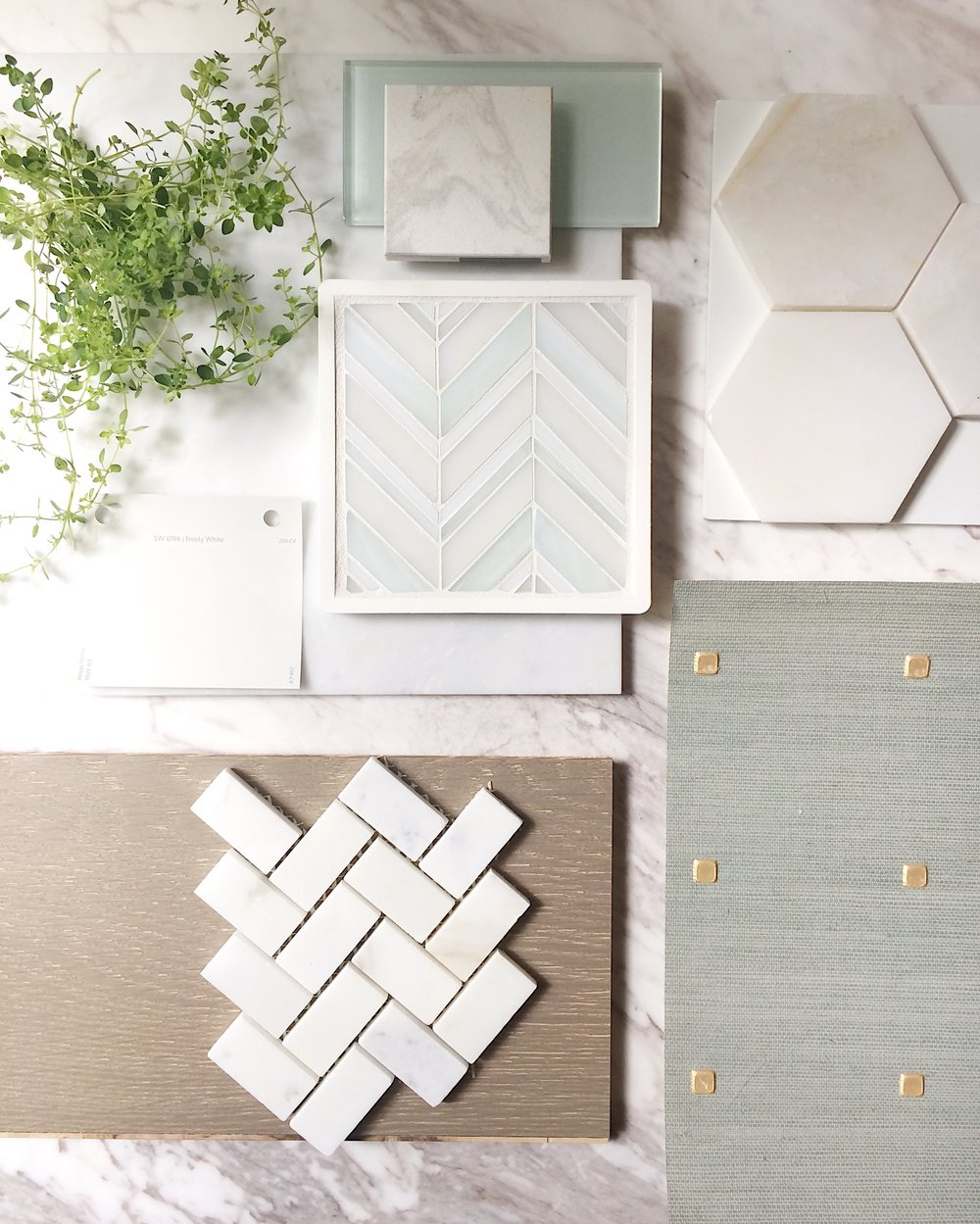 This scheme was sparked by the beautiful glass chevron-patterned tile we selected as a focal point for a master bath.