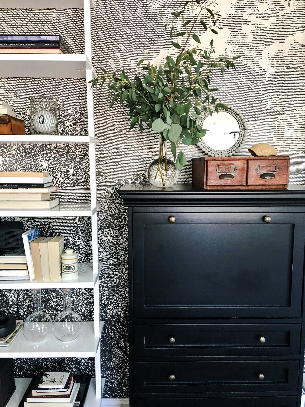 A variety of vintage collected items helps provide character to a new shelving set we recently styled.