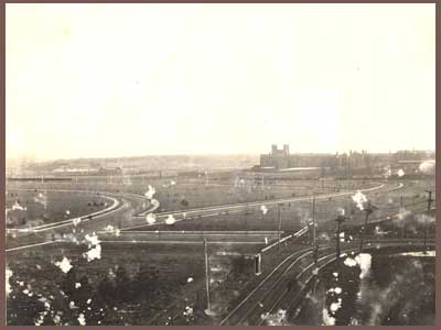 "Looking southeast ca. 1906-07 at the intersection of Center St with Westgate and Waterman, and Center's termination on the western edge of Parkview at the street car line.  Westgate Ave continues diagonally to the right to the distant curve around Pershing Park.  Washington Univ. is just beyond.  Parkview may have been a very different place, or never existed, had a scheme to build a bullfighting ring in this very area where Westgate, Waterman and Center meet come to fruition.  The origin of this proposal is not clear, possibly  a ""wild idea"" for the World's Fair.  Urban legend further has it that the prospect was instrumental in U. City's passing of an ordinance banning bullfighting and bear-baiting shortly after its incorporation.  ---Photo from the Archives of the University City Public Library, reproduced with permission.  Visit the Library's website to see other historic Univ. City photos."