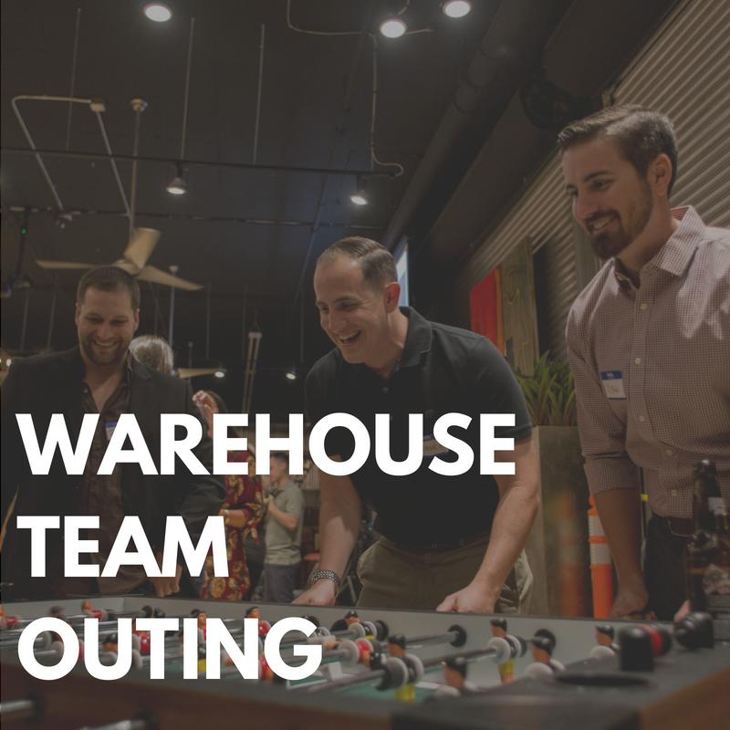 Men-Playing-Foosball-at-Rail-Yard-Warehouse