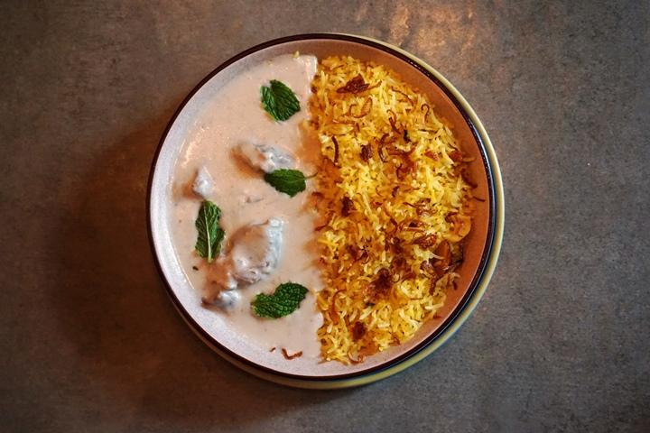 Kashmiri Yakhni served with a saffron pulao