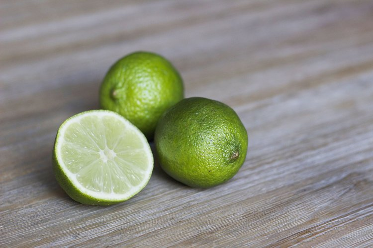 Three limes with one cut in half
