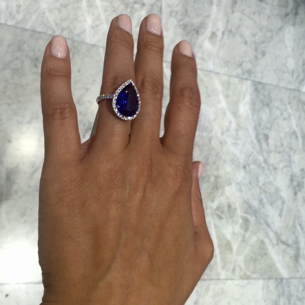 Pear shaped blue sapphire surrounded by diamonds - a modern take on Princess Diana's engagement ring which now rests happily on the Duchess of Cambridge's wedding digit.