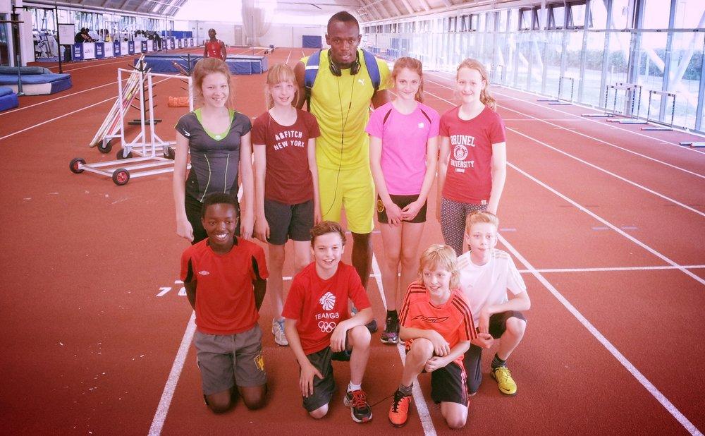 The Development Pole Vault Class of 2013 meet Usain Bolt at Training.