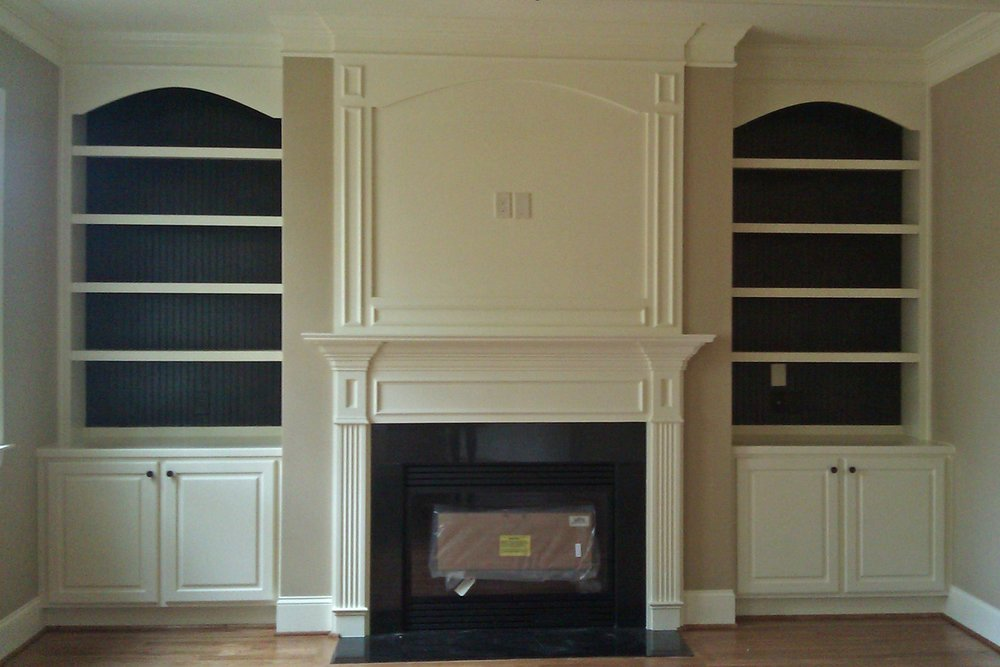 Built-in with accent bead board backing & arche detail.jpg