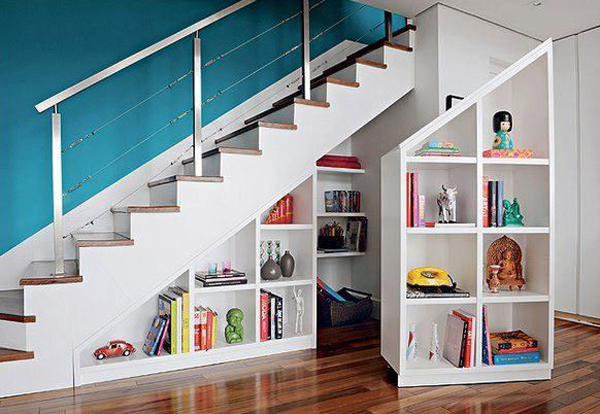 STAIRWELL BOOKCASE - Is your stairwell going unused? Add a built-in bookcase, with optional pull-outs on wheels for hidden storage. You can also convert to a small reading nook, if your stairwell has enough space.