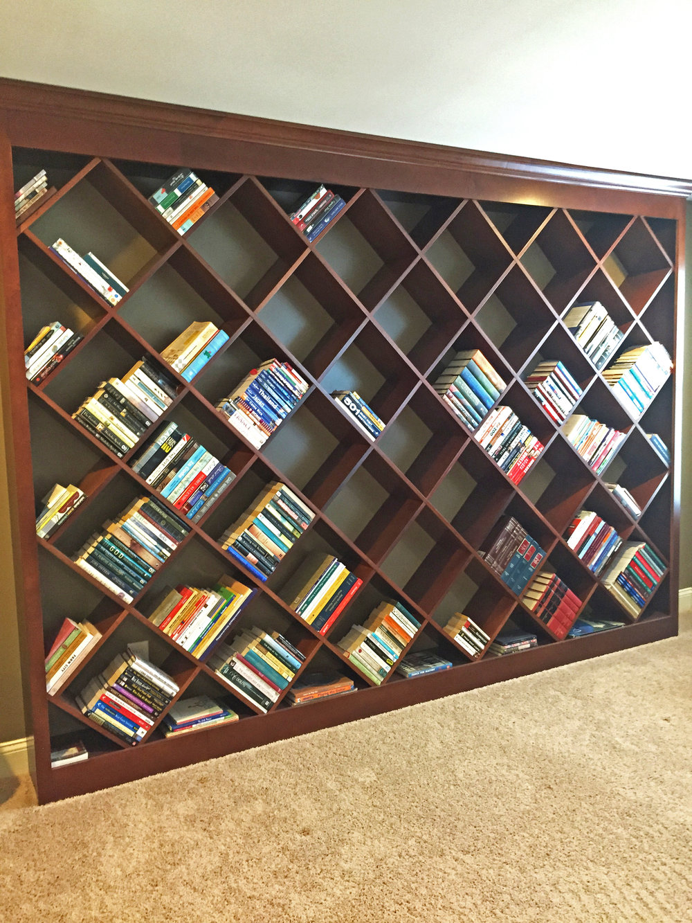 DIAGONAL BOOKCASE - If you want something different, but prefer symmetry and a classic look, a stain grade or painted diagonal bookcase would look great in your home or office.